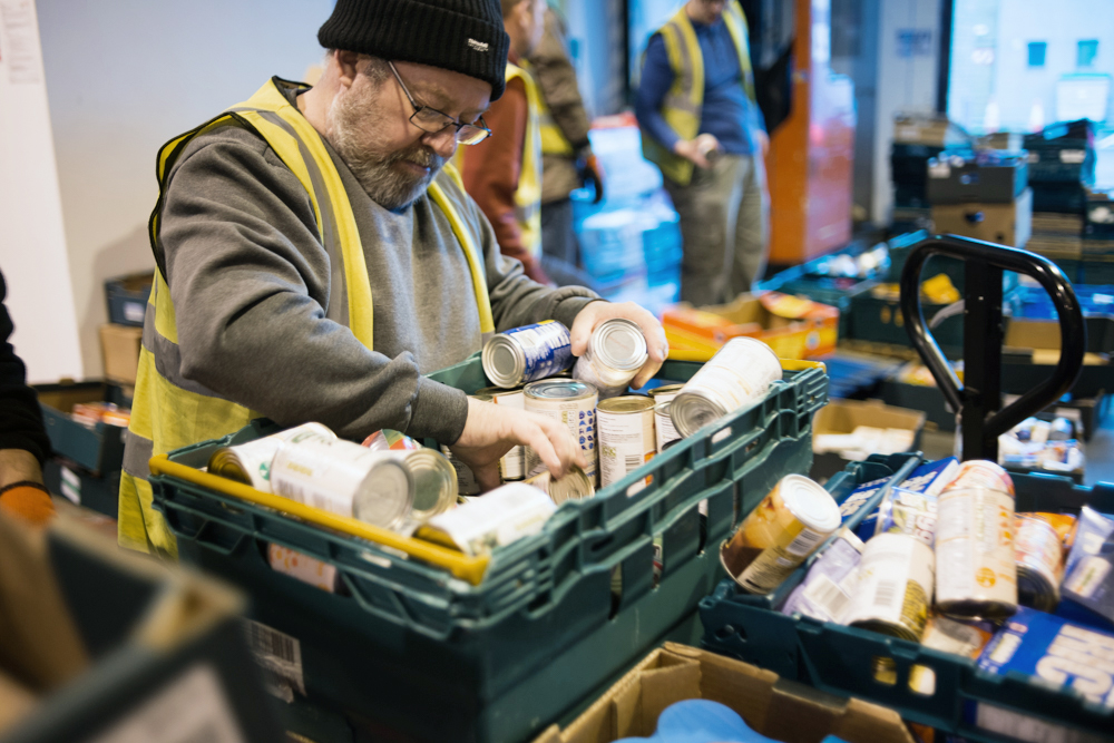 A volunteer for FareShare Northern Ireland sorts through food rescued from going to waste - it will then be redistributed to charities across the country